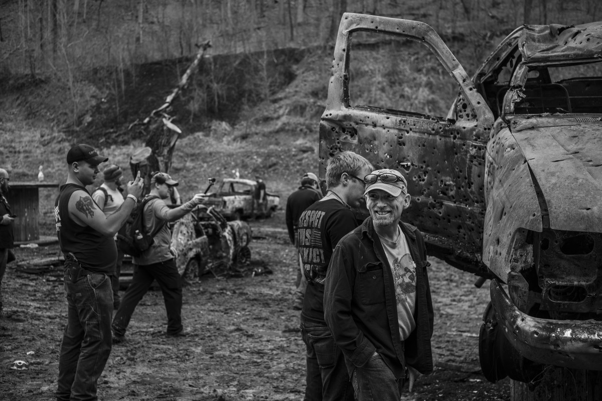 Louisville, Kentucky: Gun enthusiasts examine the wreckage at the largest machine gun event in the United States, held at the Knob Creek Gun Range, just south of the city.