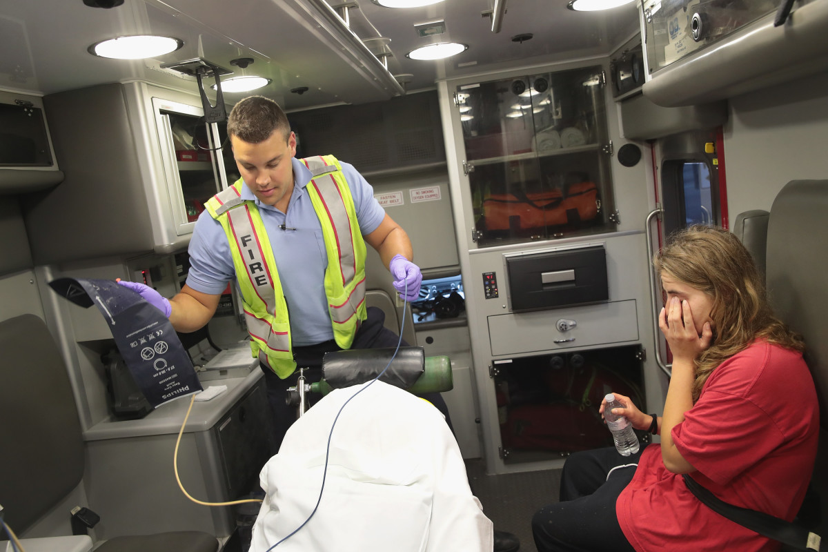 A firefighter treats a women suspected of overdosing on heroin on July 14th, 2017, in Rockford, Illinois.