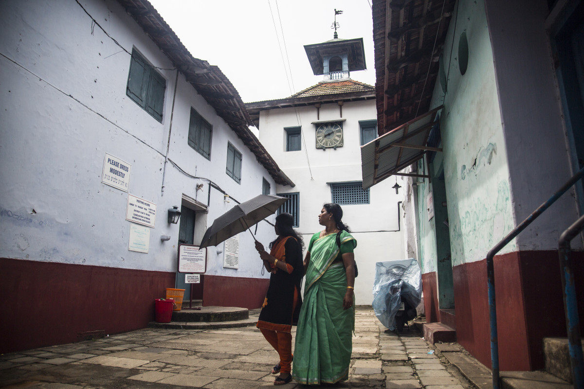 "Paradesi Synagogue, India's oldest active synagogue, sits at the end of Mattancherry's ""Jew Town."" With the Jewish community dwindling in Mattancherry, the synagogue's main visitors are now tourists."