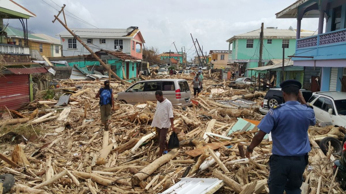 Residents survey the damage from Hurricane Maria in Roseau, Dominica, on September 20th, 2017.