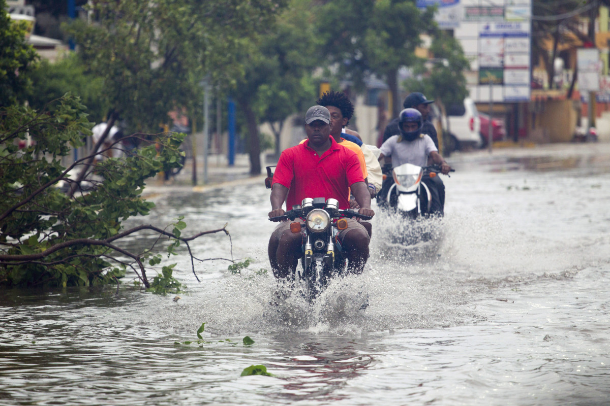 Men ride motorcycles along the flooded streets of Punta Cana in the Dominican Republic on September 20th, 2017.