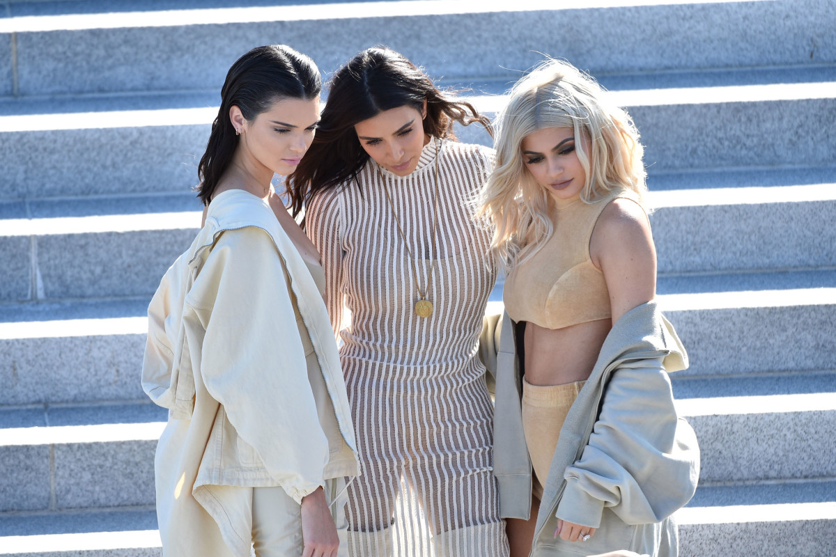 Kendall Jenner, Kim Kardashian, and Kylie Jenner attend the Kanye West Yeezy Season 4 fashion show on September 7th, 2016, in New York City.