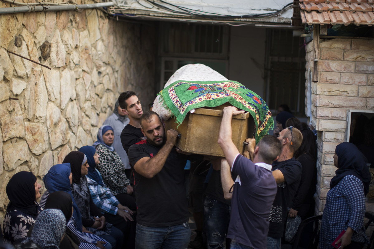 Friends and family carry Yosef Othman's coffin on September 26th, 2017, in Jerusalem, Israel, at the funeral for one of three guards killed during an attack at a West Bank settlement.