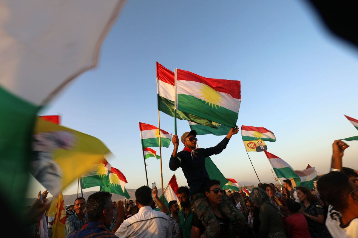Syrian Kurds wave the Kurdish flag in the Syrian city of Qamishli on September 27th, 2017, during a gathering in support of the independence referendum in Iraq's northern Kurdish region.