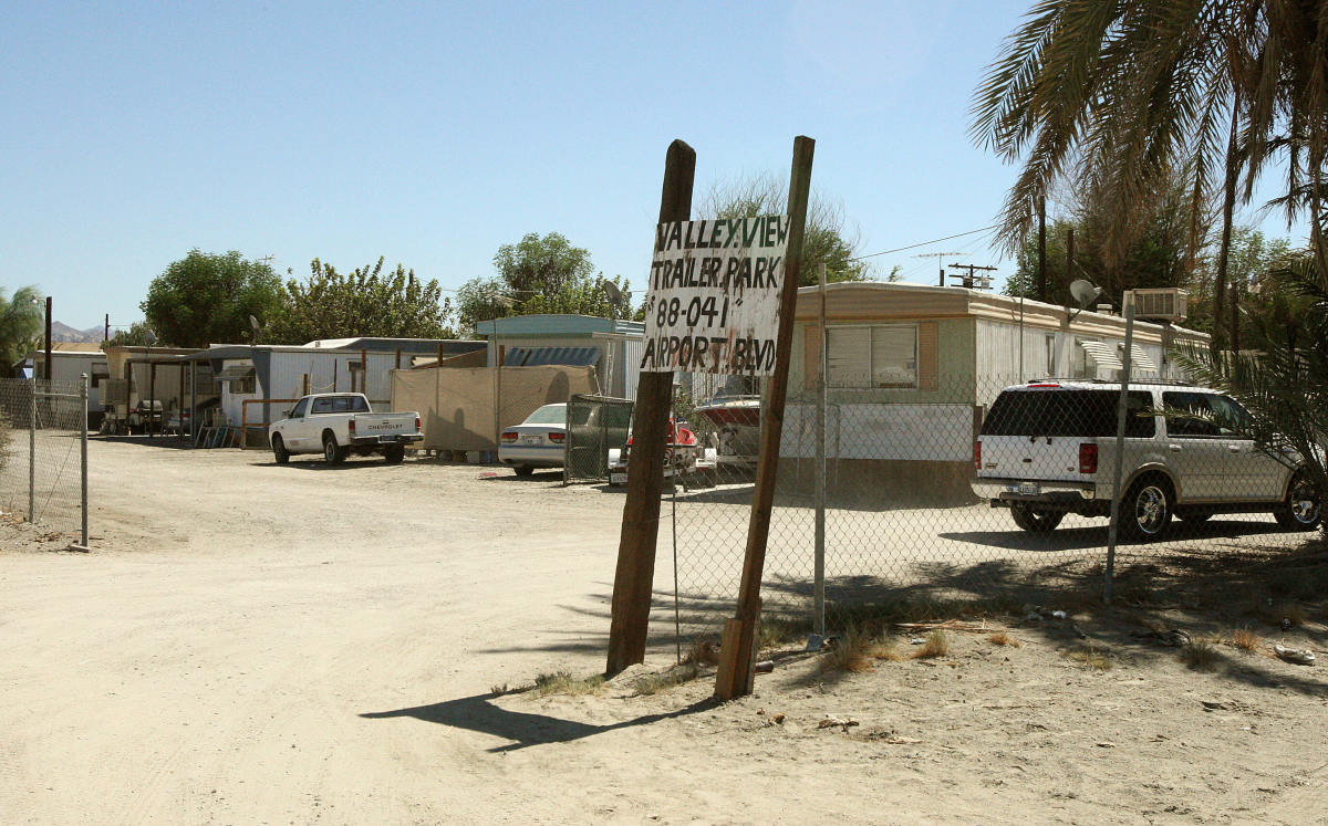 One of the many trailer parks catering to undocumented workers in Thermal, California, an hour and 30 minute drive to the Mexican border. Thermal and the surrounding unincorporated towns share the Coachella Valley with the world-class golf resorts and private clubs of Palm Springs less than 30 miles away.