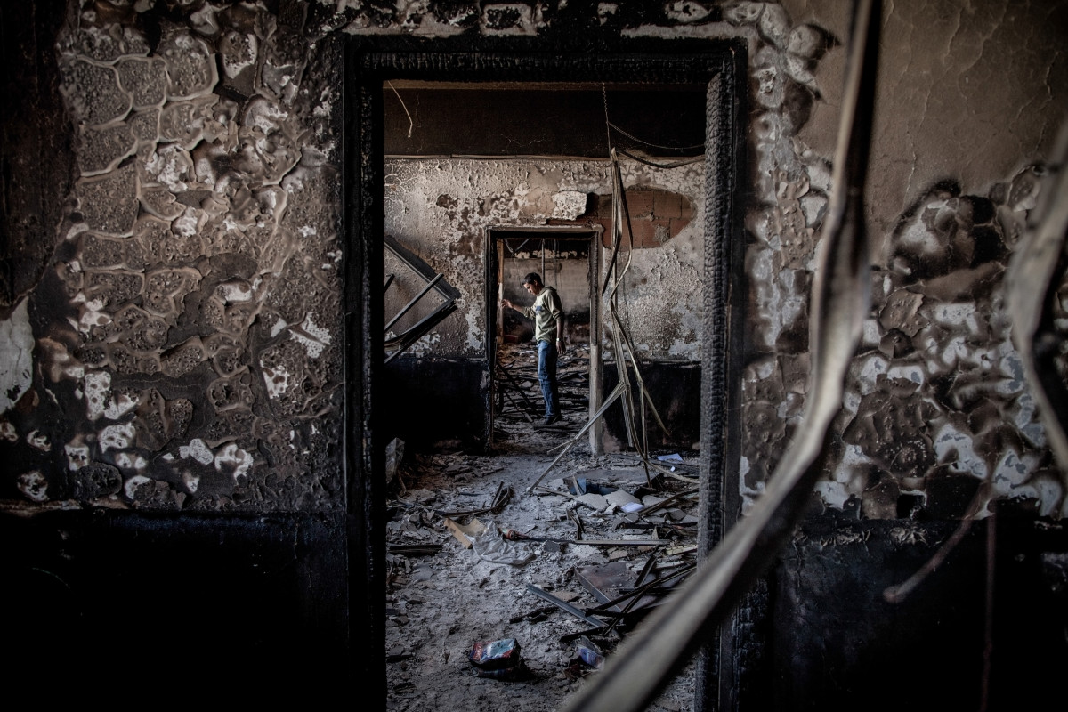 Benghazi, Libya: On the outskirts of the city, a man stands in a government building that was burned by the opposition in February of 2011, at the beginning of a revolution against the 41-year regime of Muammar Gaddafi.
