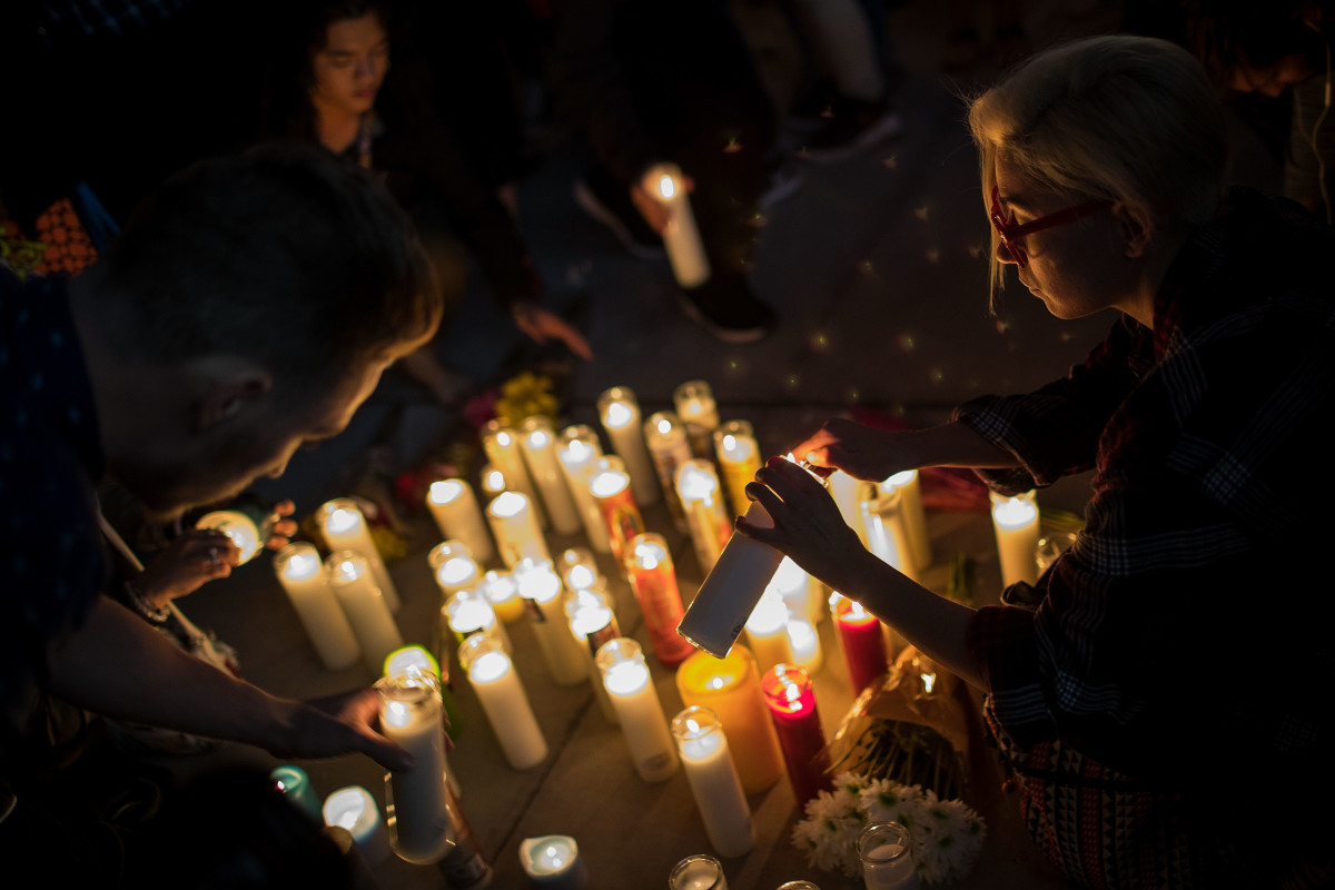 Mourners light candles during a vigil in Las Vegas, Nevada, held on October 2nd, 2017.