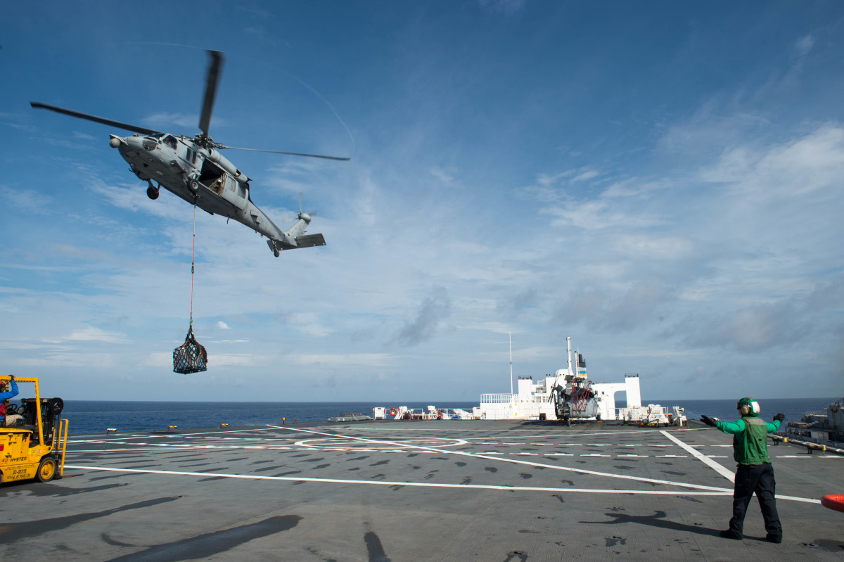 An MH-60S Sea Hawk helicopter attached to the Sea Knights Sea Combat Squadron 22 delivers cargo to the hospital ship USNS Comfort in support of humanitarian relief operations in Puerto Rico.