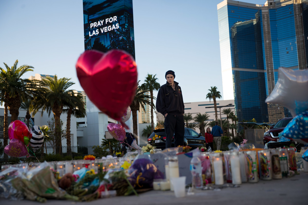 Matthew Helms, who worked as a medic the night of the shooting, visits a makeshift memorial for the victims of Sunday night's mass shooting on the north end of the Las Vegas Strip on October 3rd, 2017, in Las Vegas, Nevada.