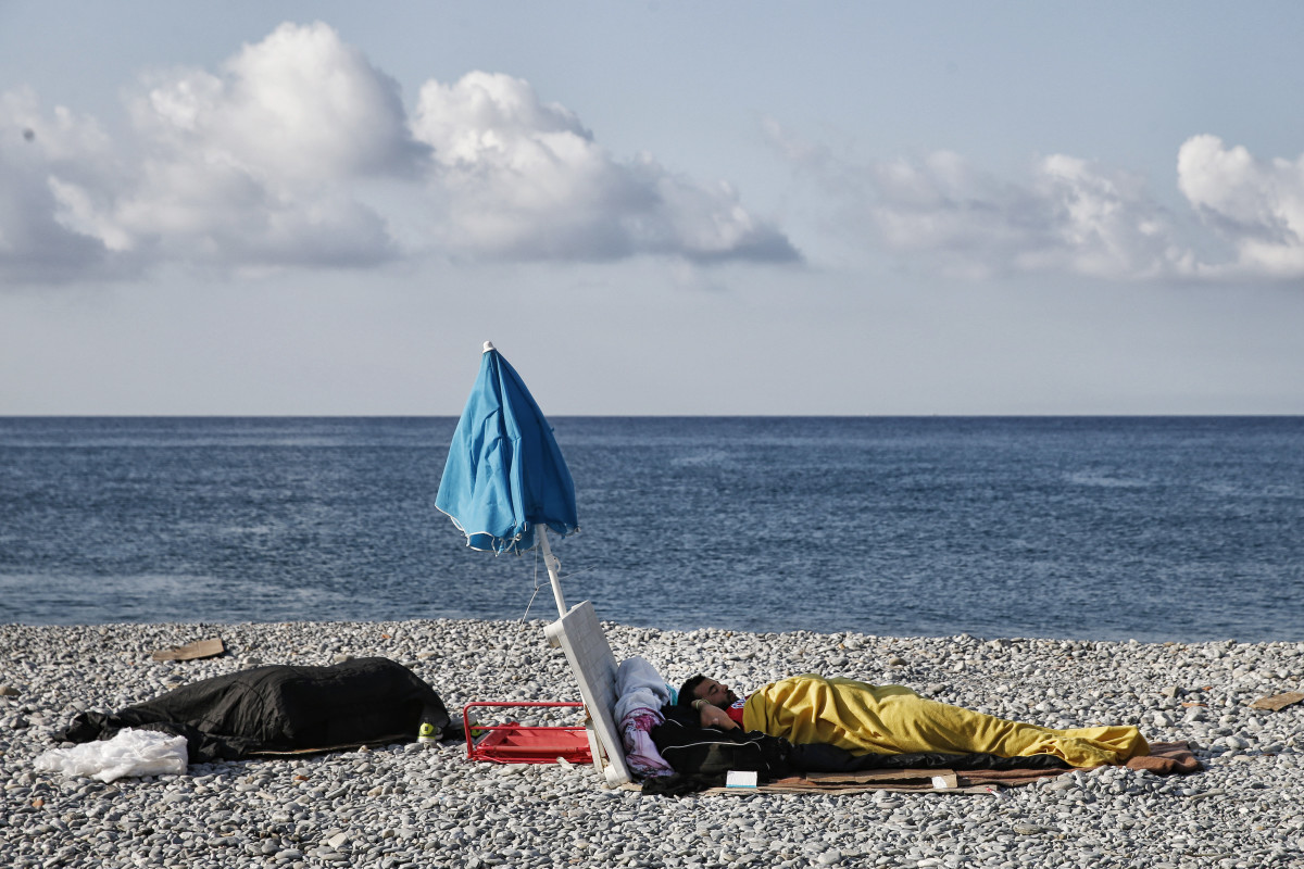 Migrants sleep on the beach on August 9th, 2017, in Ventimiglia, near the French border. Since the beginning of 2017, more than 117,000 people have made the perilous Mediterranean crossing into Europe from North Africa—more than 96,000 of them arriving in Italy.