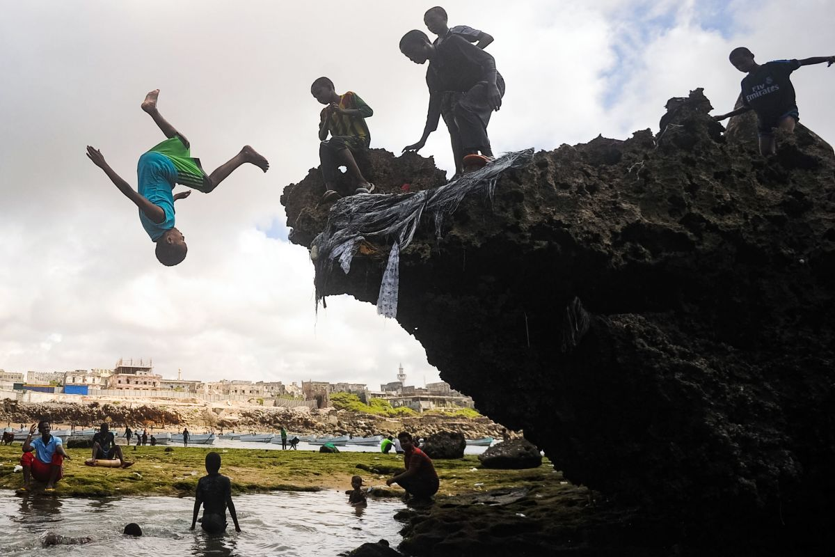 Somali children dive, play, and swim on the seashore of Hamarweyne district in Mogadishu, Somalia, on October 6th, 2017.