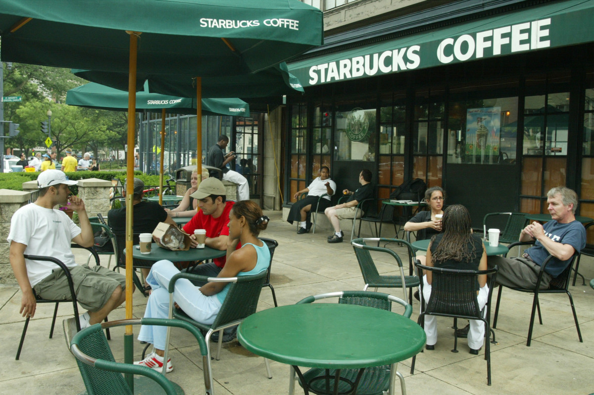 Customers sit outside a Starbucks in Washington, D.C.