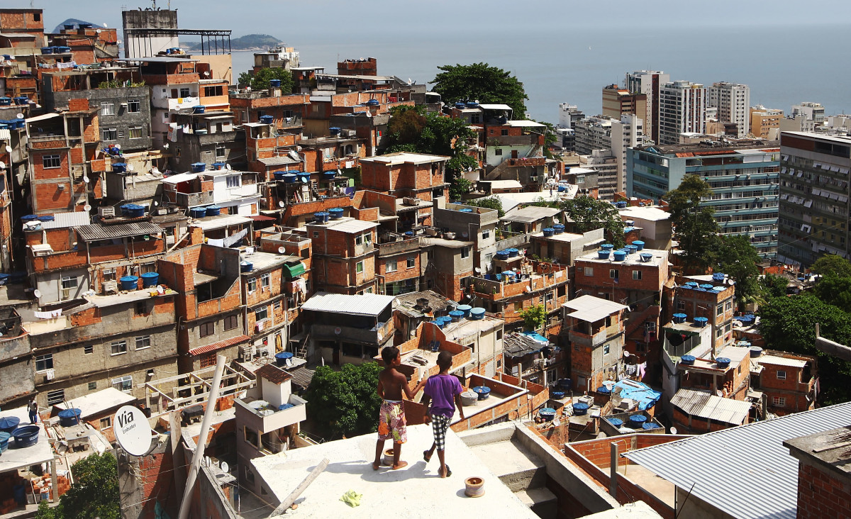 Boys gather while flying kites in the Cantagalo shantytown community next to neighboring Pavao-Pavaozinho in Rio de Janeiro, Brazil.