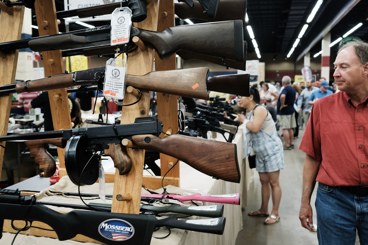Gun enthusiasts visit a gun show where thousands of different weapons are displayed for sale on July 10th, 2016, in Fort Worth, Texas.