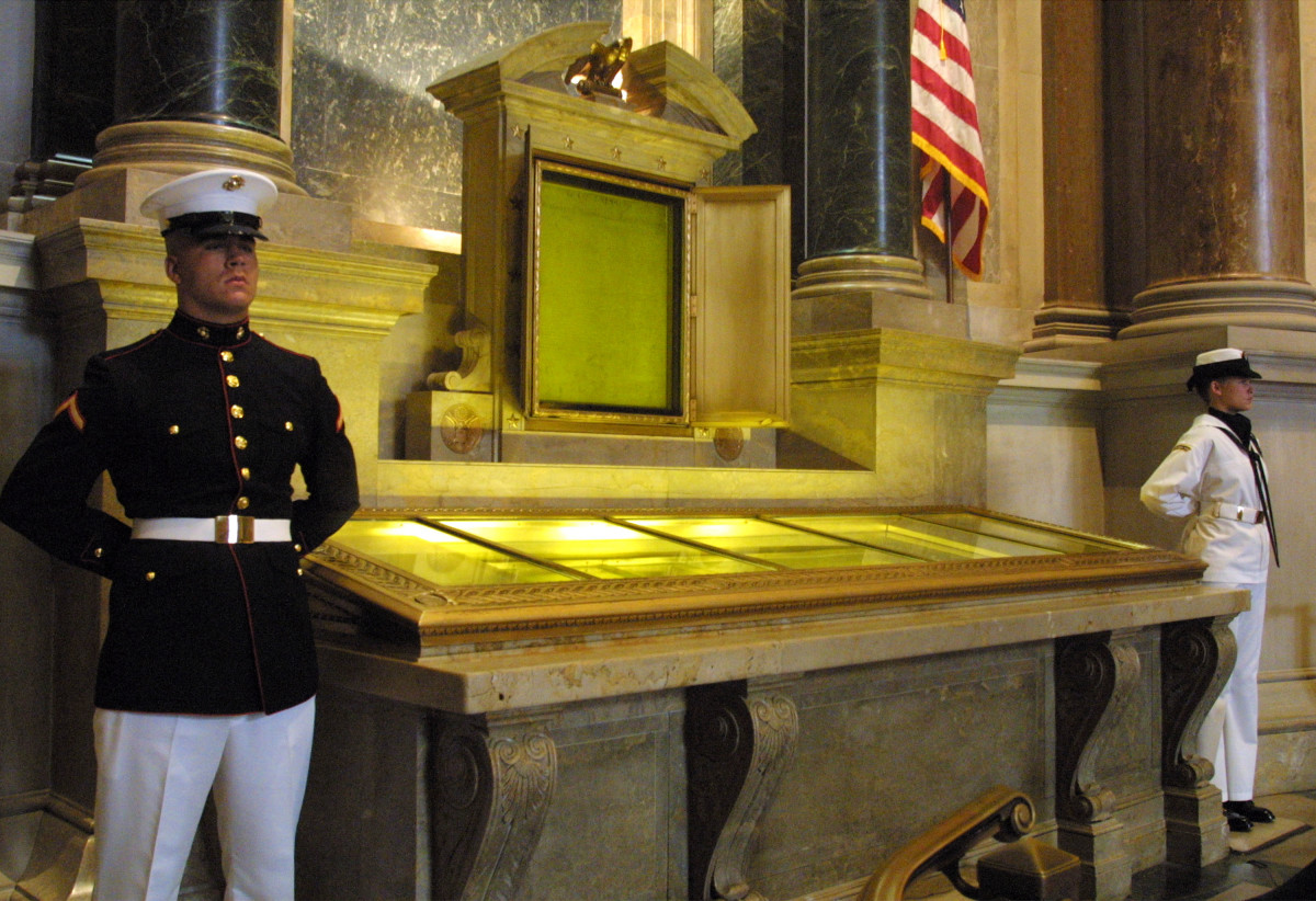 An honor guard stands next to the original copies of the Declaration of Independence, the Constitution, and the Bill of Rights on July 4th, 2001, at the National Archives in Washington, D.C.