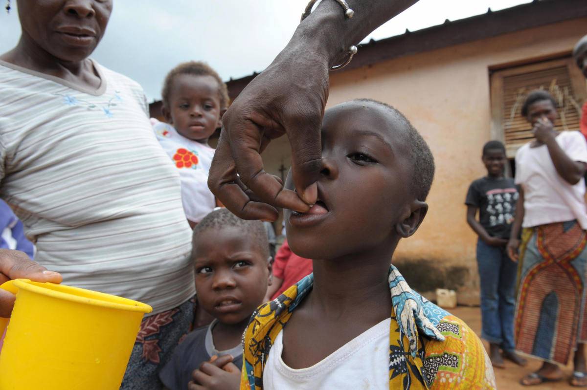 A nurse, Mamadou Kone, gives medicine for river blindness, caused by a parasitic worm and spread by the bite of an infected blackfly, on September 27th, 2008.