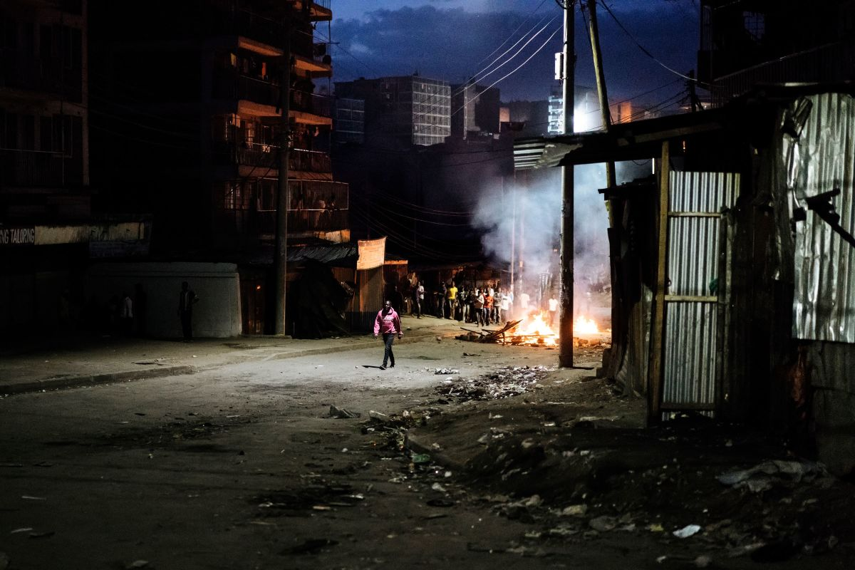 Protesters gather around a burning barricade in the Mathare slums in Nairobi, Kenya, on October 30th, 2017, during demonstrations following the announcements of the presidential election results.