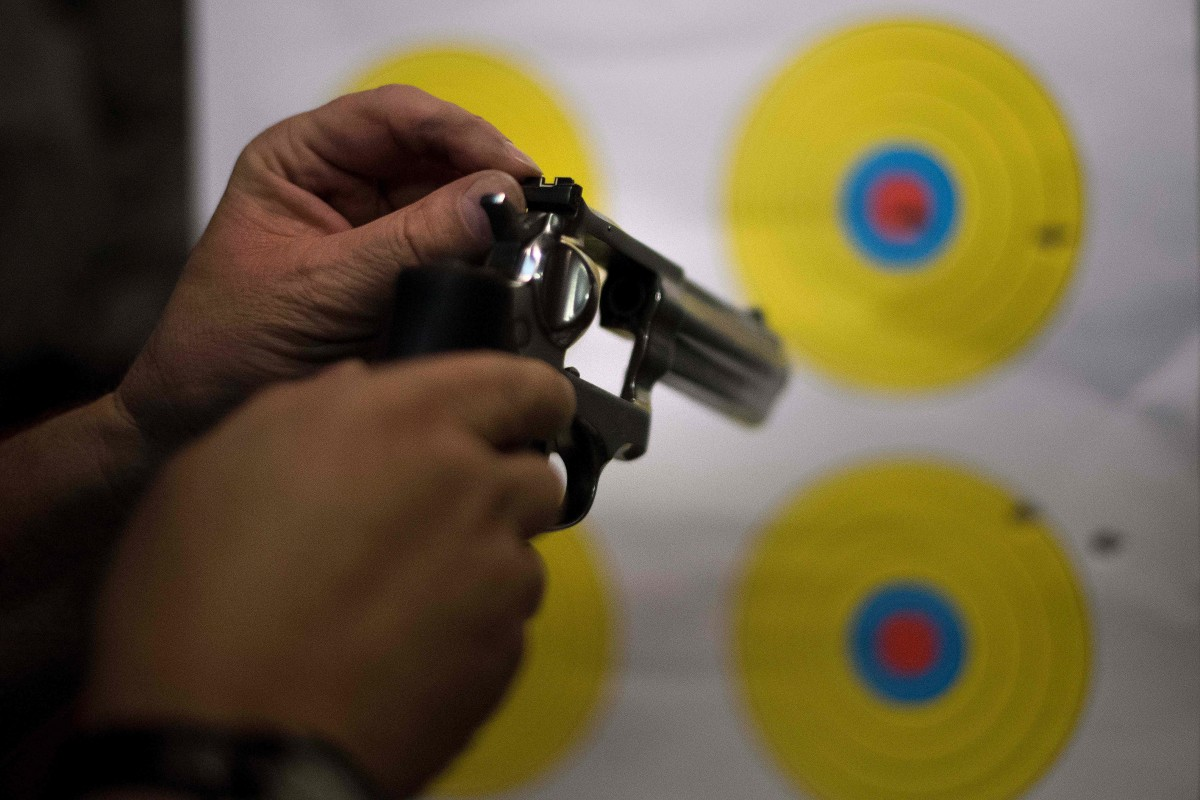 A man adjusts the sights on his .357 revolver at the Lynchburg Arms & Indoor Shooting Range in Lynchburg, Virginia, on October 20th, 2017.