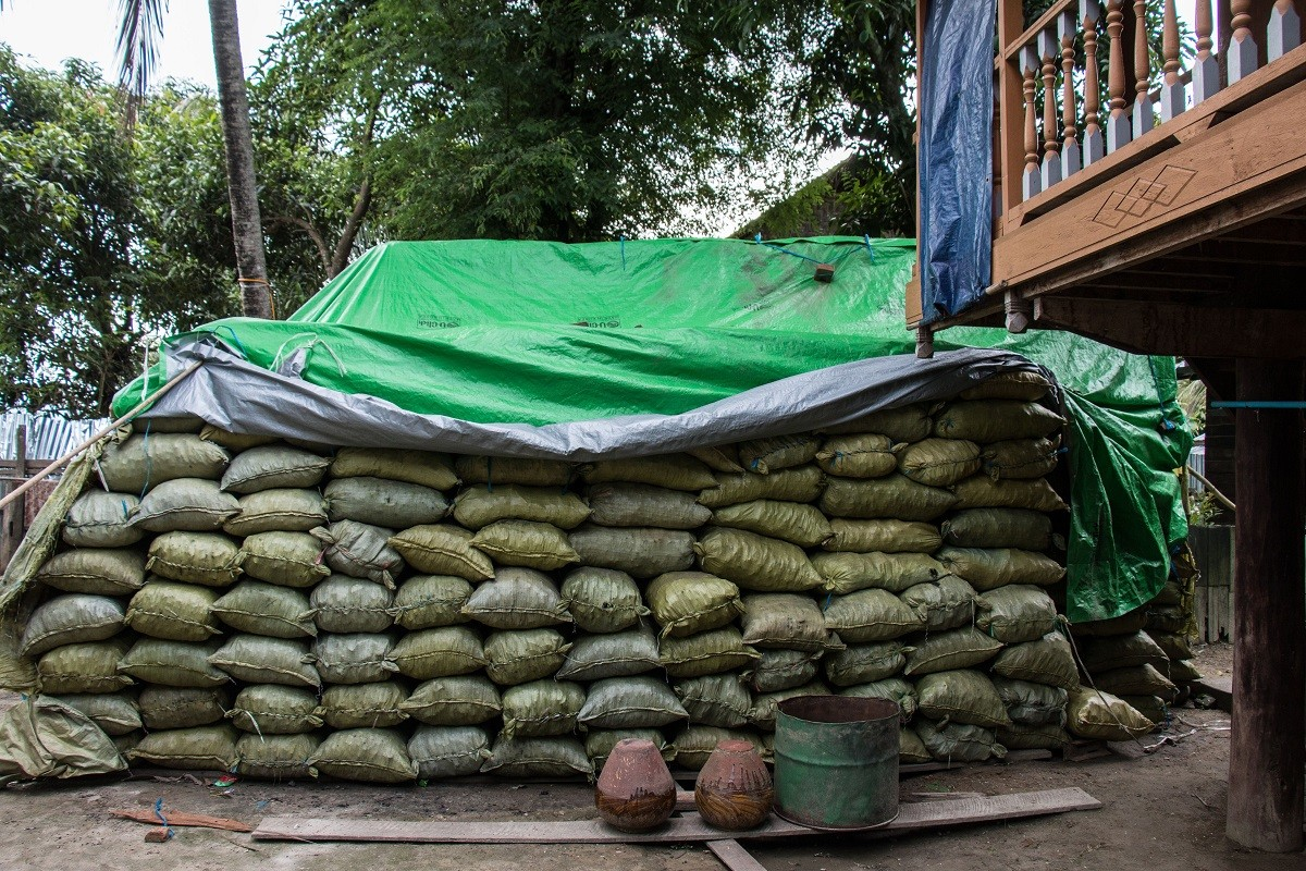 Charcoal bags waiting to be transported near Katha, Myanmar. The charcoal will be sent to Bhamo before going to China.