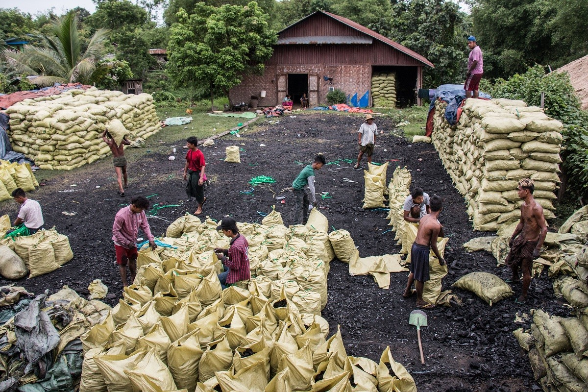 Charcoal bags stored in a lot in Bhamo, Myanmar. Approximately 500 bags are held here, before being loaded onto trucks and sent to China, which is about 50 miles away.