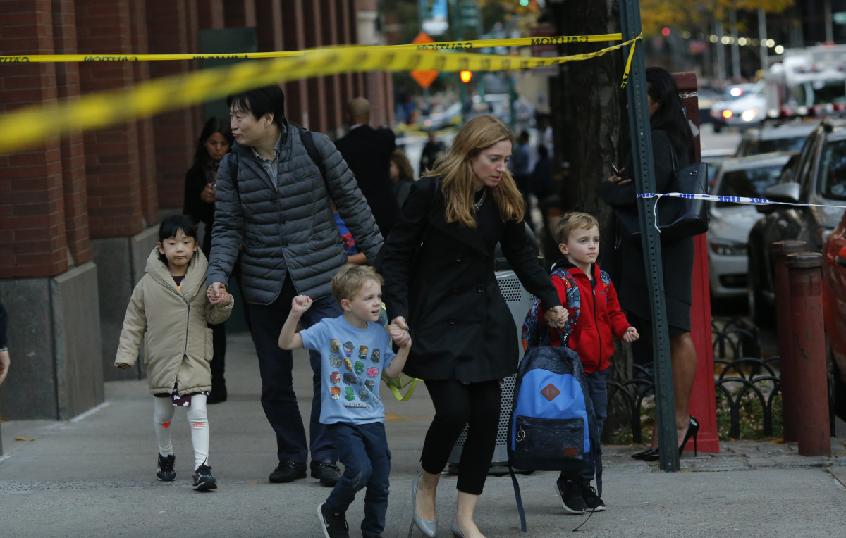 Children are evacuated from a school as emergency personal respond after a man driving a rental truck struck and killed eight people on a jogging and bike path in Lower Manhattan on October 31st, 2017, in New York City.