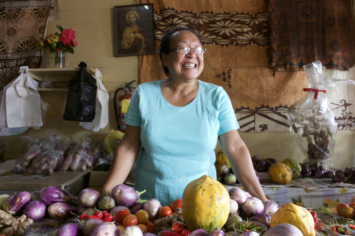 Teresa Yee Show presiding over a vegetable counter at the market in Levuka.