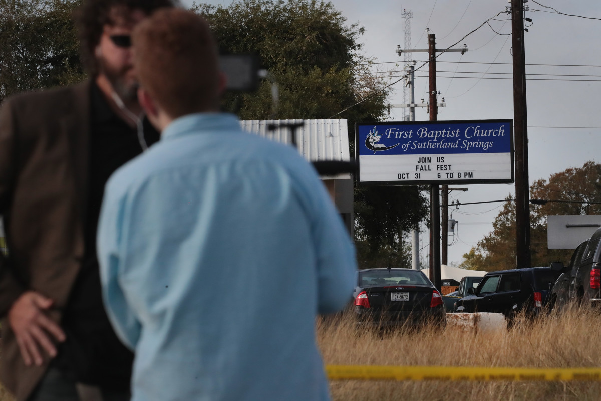 Emergency vehicles are parked outside the first Baptist Church on November 6th, 2017, in Sutherland Springs, Texas.