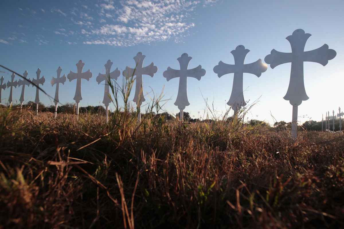 Crosses stand in a field on the edge of town to honor the 26 victims killed at the First Baptist Church on November 6th, 2017, in Sutherland Springs, Texas.
