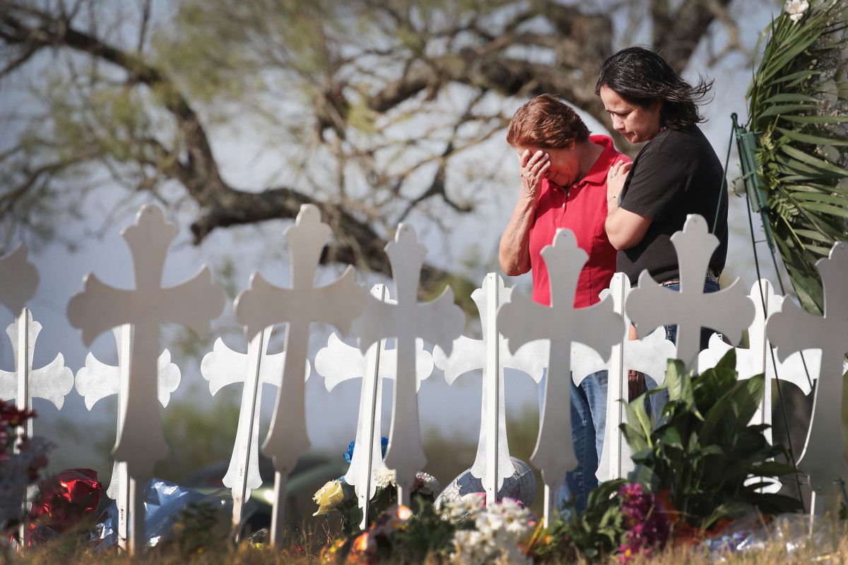 Maria Durand and her daughter, Lupita Alcoces, visit a memorial on the edge of town honoring the 26 worshippers killed at the First Baptist Church on November 7th, 2017, in Sutherland Springs, Texas. Durand, who teaches bible study at the church, lost several friends in the shooting.