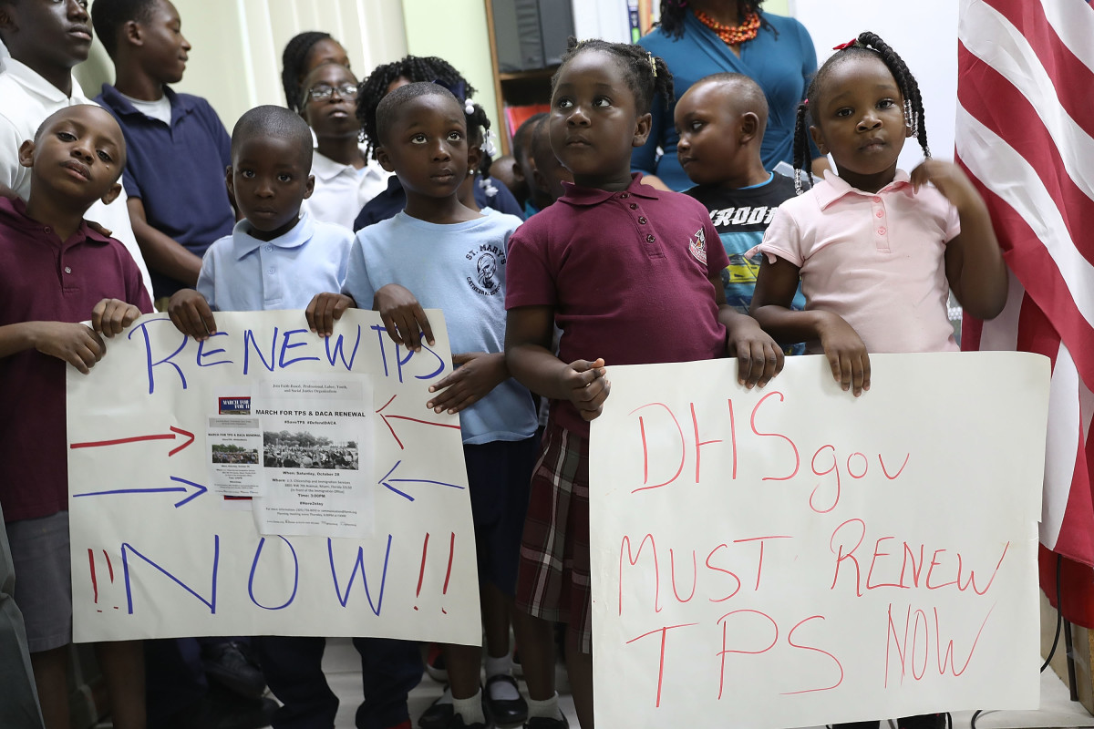 Children hold posters asking the federal government to renew Temporary Protected Status during a press conference about TPS for people from Haiti, Honduras, Nicaragua, and El Salvador at the office of the Haitian Women of Miami on November 6th, 2017, in Miami, Florida.