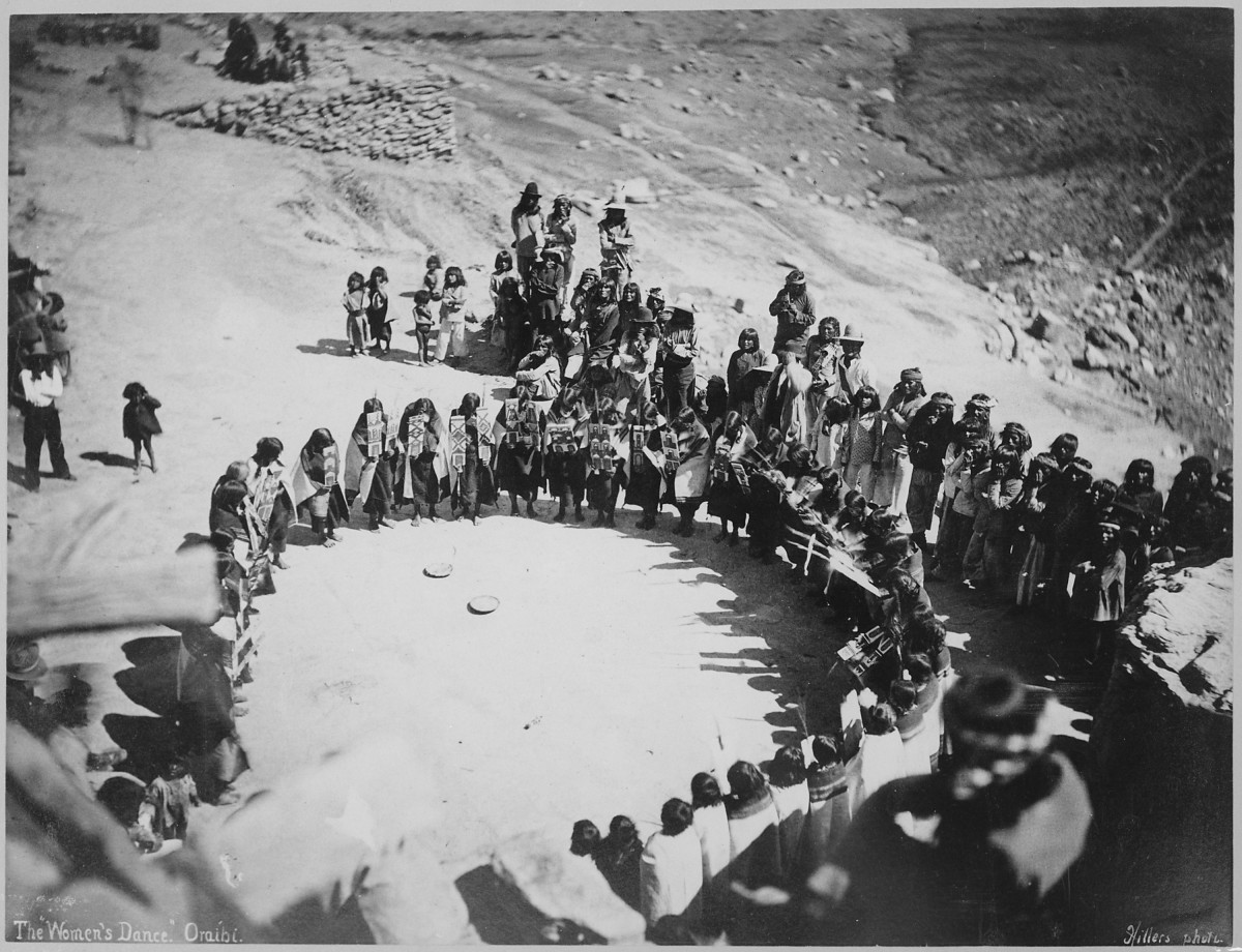 An archival image of Hopi women dancing in Oraibi, Arizona.