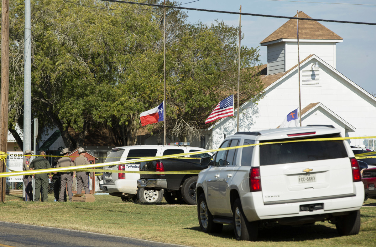 Law enforcement officials gather near the First Baptist Church following a shooting on November 5th, 2017, in Sutherland Springs, Texas