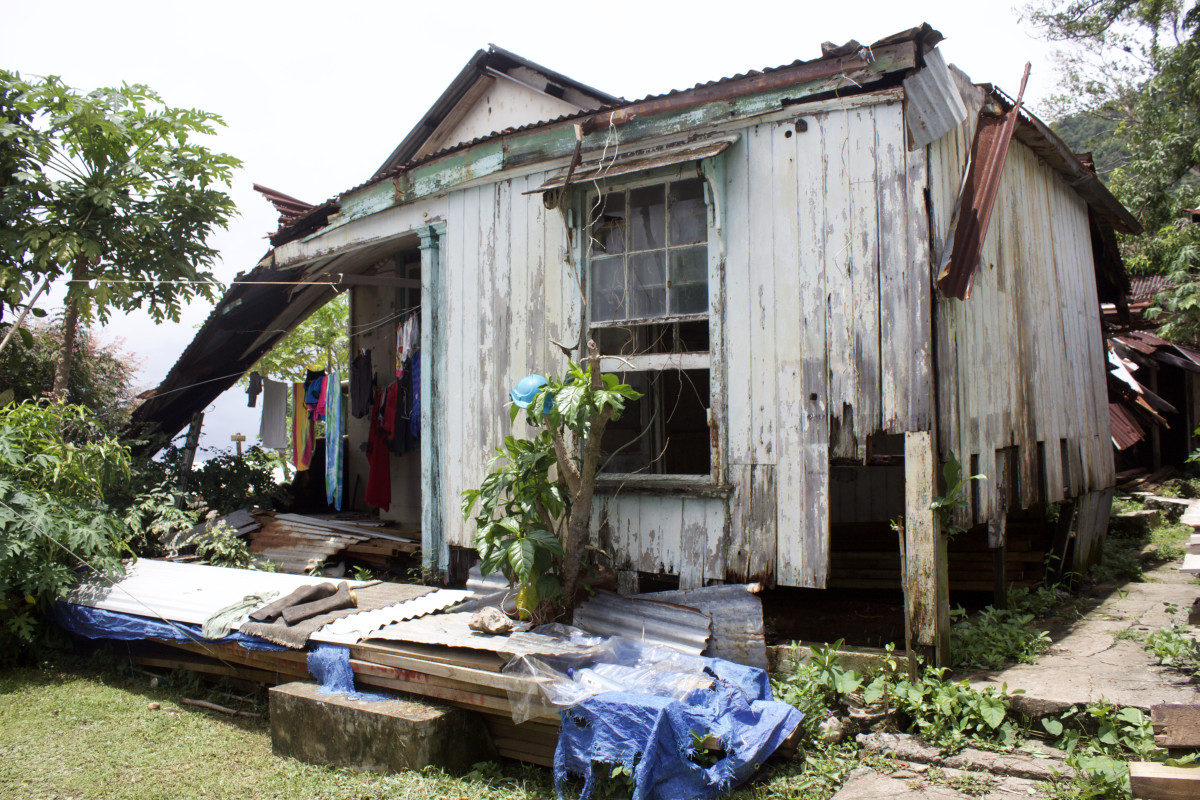 Flora's former house, which collapsed during Cyclone Winston. When it rains, the families hang clothes to dry under the remaining roof because there's no room in the tents.