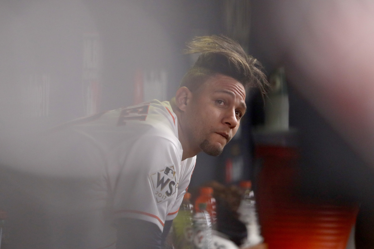 Yuli Gurriel looks on from the dugout during the fourth inning against the Los Angeles Dodgers in game five of the World Series at Minute Maid Park on October 29th, 2017, in Houston, Texas.