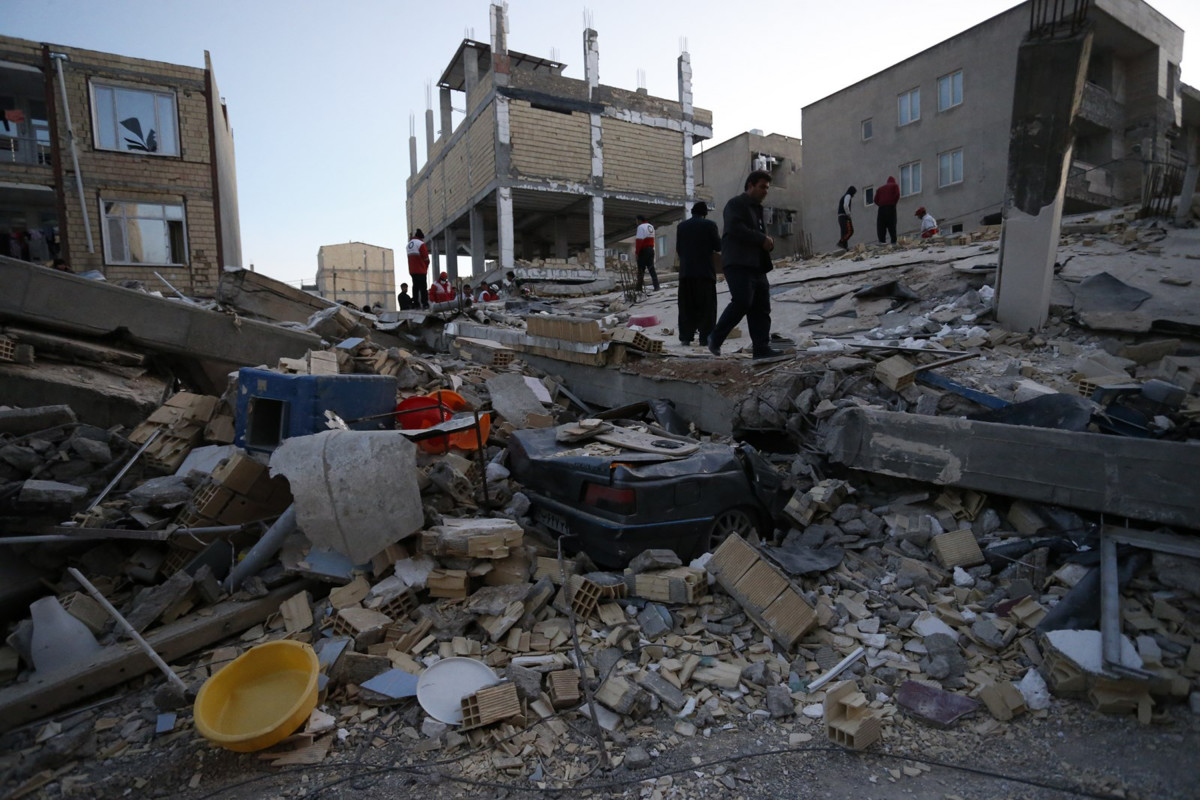 Residents and responders conduct search-and-rescue work following the earthquake at Sarpol-e Zahab in Iran's Kermanshah province on November 13th, 2017.