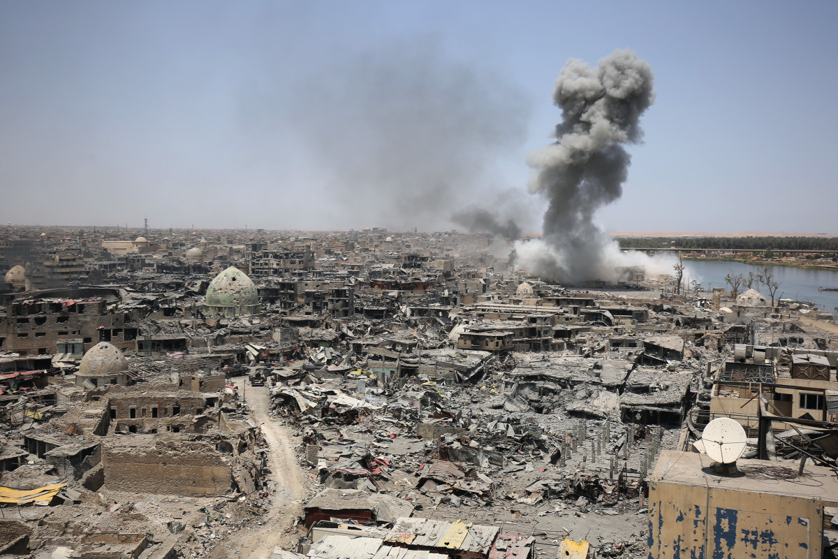 A picture taken on in in Mosul, Iraq, on July 9th, 2017, shows smoke billowing following an airstrike by U.S.-led international coalition forces targeting ISIS.