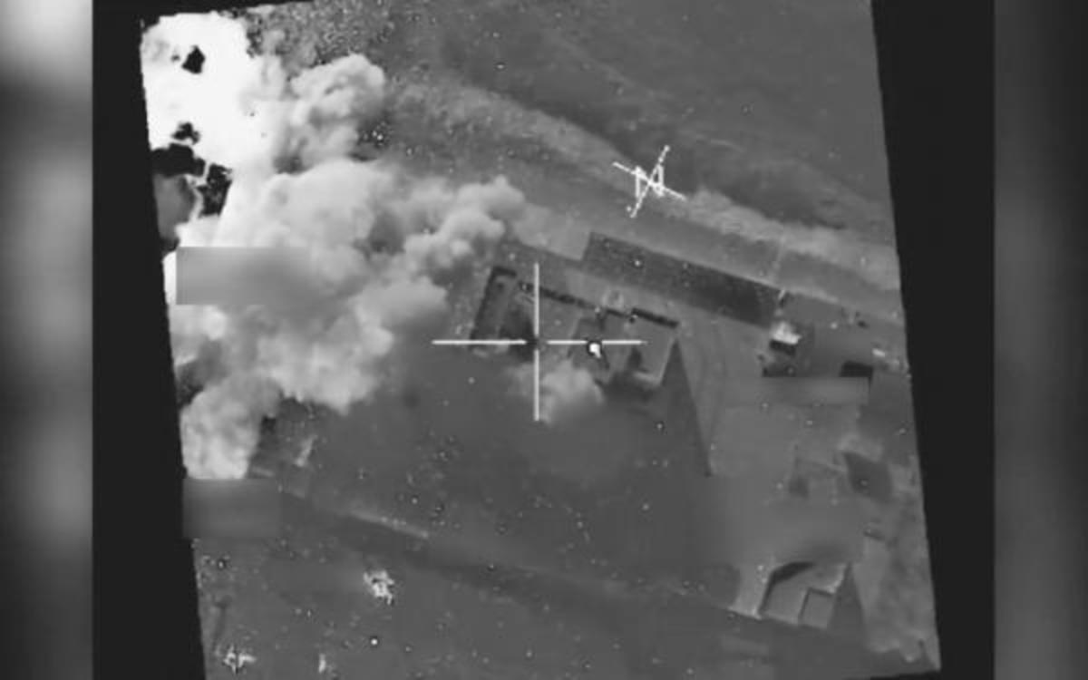 A coalition airstrike destroys a Da'esh weapons cache near Mosul, Iraq.