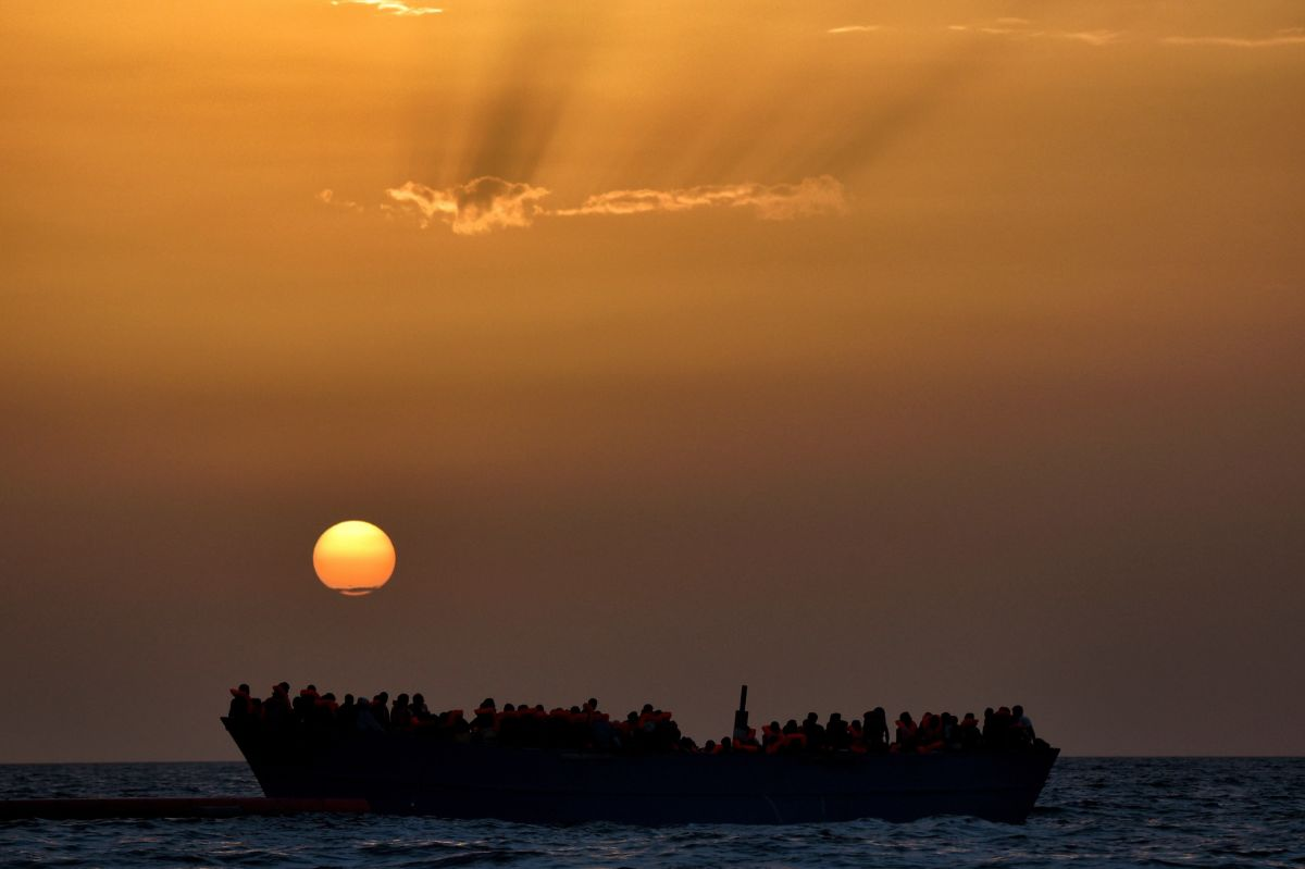 Migrants wait to be rescued as they drift at sunset in the Mediterranean Sea some 20 nautical miles north off the coast of Libya.