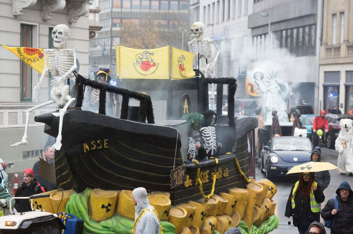 Demonstrators dressed as human skeletons stand on a float protesting nuclear waste on November 11th, 2017, in Bonn, Germany.