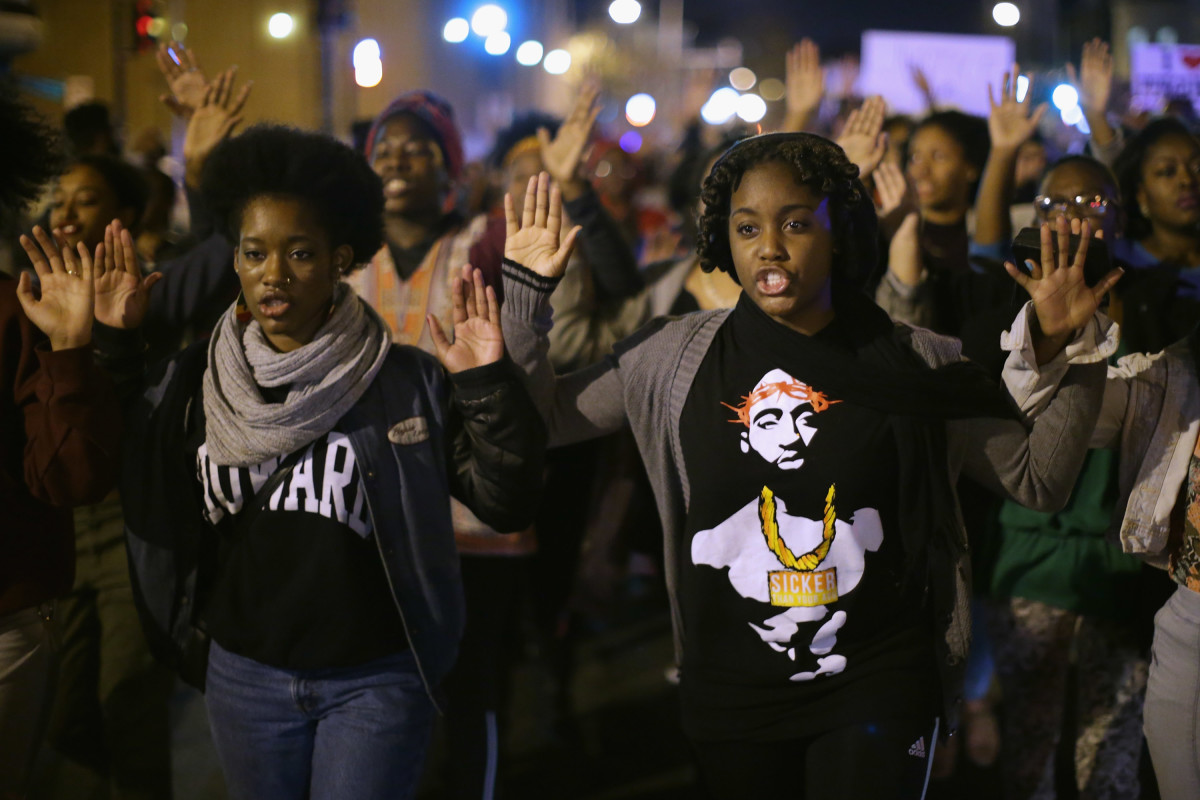 Hundreds of demonstrators, many of them Howard University students, march down the middle of U Street Northwest in Washington, D.C.