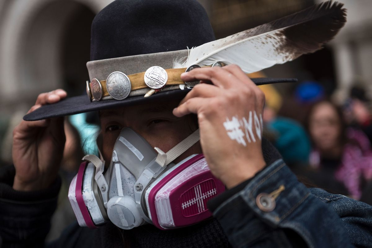 An activist adjusts his hat while protesting the Keystone XL Pipeline during the Native Nations Rise protest on March 10th, 2017, in Washington, D.C.