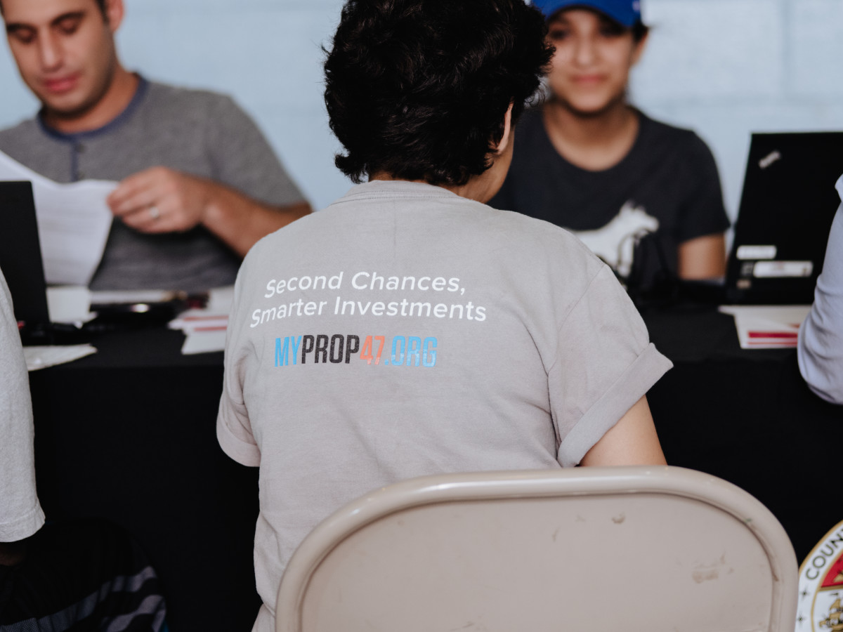 A supporter of Proposition 47, a law that reduces certain low-level crimes from potential felonies to misdemeanors, attends a free legal clinic for people looking to remove marijuana offenses from their records.
