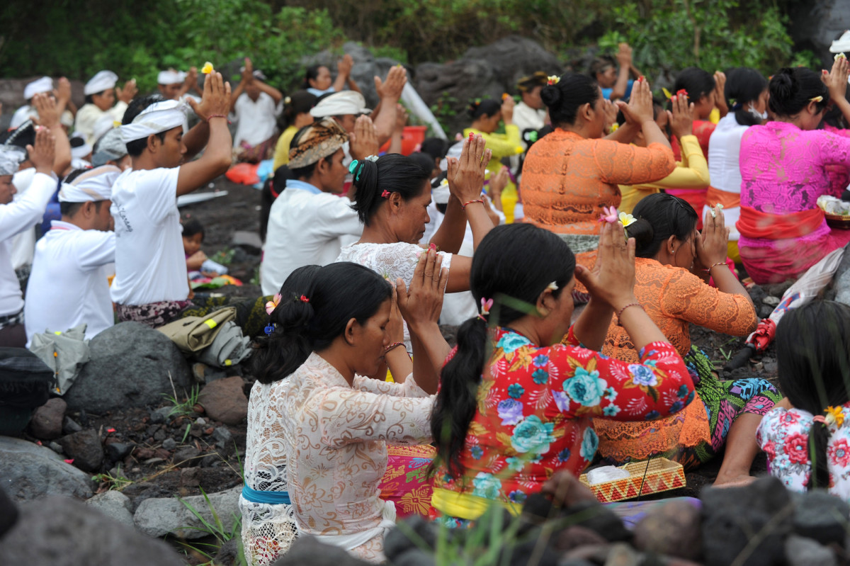 Balinese Hindus take part in a ceremony, where they pray near Mount Agung in hope of preventing a volcanic eruption, in Muntig village of the Kubu sub-district in Karangasem Regency on Indonesia's resort island of Bali on November 26th, 2017.