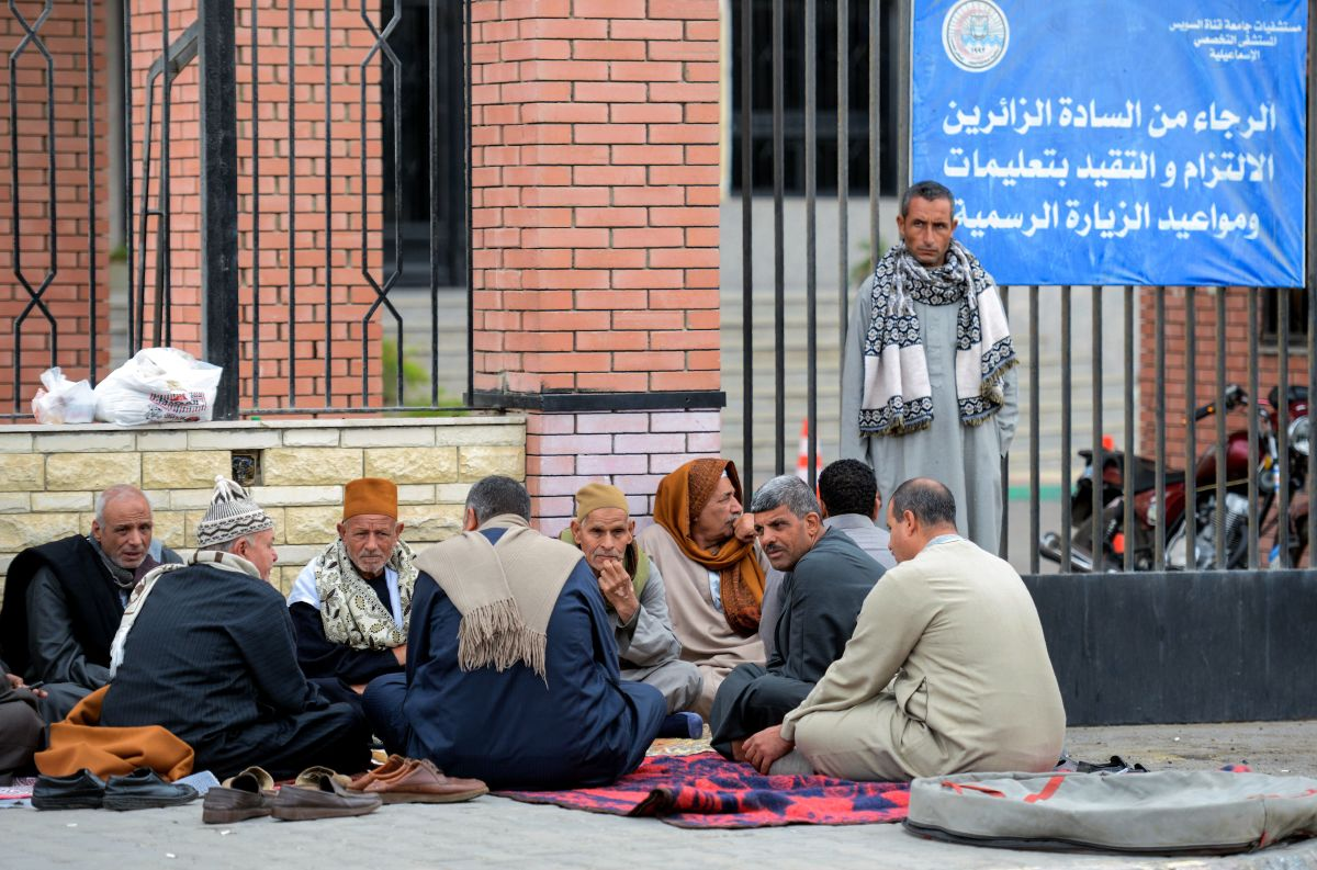 Relatives of the victims of the bomb and gun assault on the North Sinai Rawda mosque wait outside the Suez Canal University hospital in the eastern port city of Ismailia on November 25th, 2017.