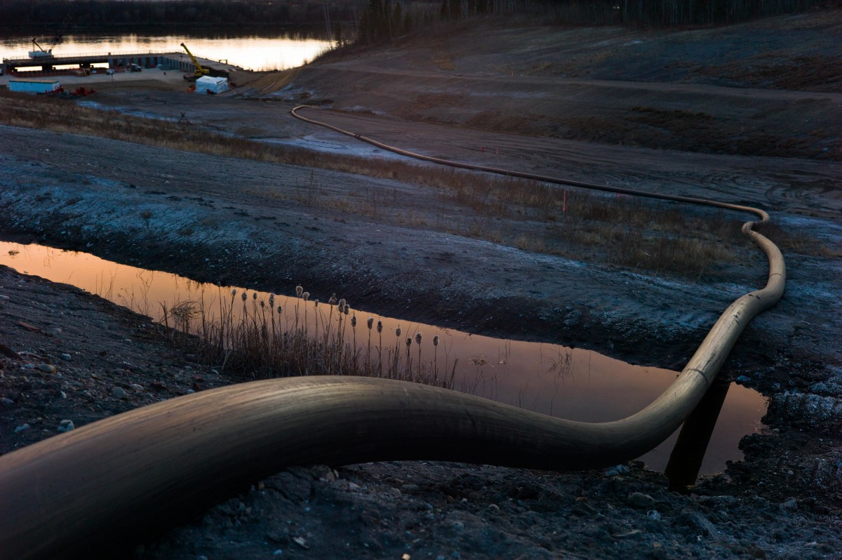 A water intake pipe for oil sands operations leads downhill to the Athabasca River on April 28th, 2015, north of Fort McMurray, Canada.