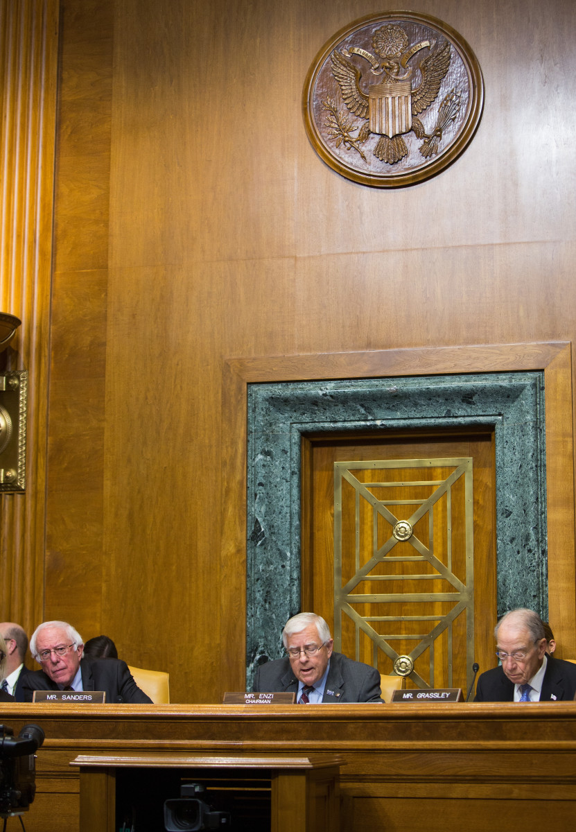 Senator Bernie Sanders (I-Vermont), Senate Budget Committee Chairman Mike Enzi (R-Wyoming), and Senator Chuck Grassley (R-Iowa) attend the full committee mark-up of the tax reform legislation on November 28th, 2017.