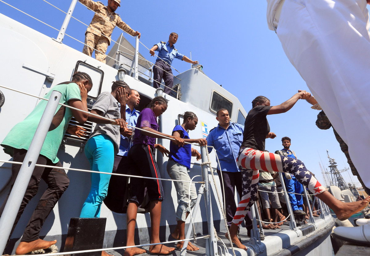 Asylum seekers from Africa disembark a Libyan coast guard boat as they arrive at a naval base in Tripoli after being rescued in the Mediterranean Sea on August 28th, 2017.