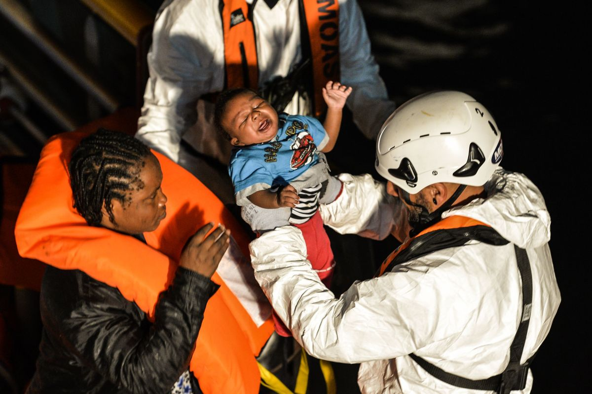 A rescue team member takes a baby aboard a rescue ship during an operation off the Libyan coast in the Mediterranean Sea on November 5th, 2016.