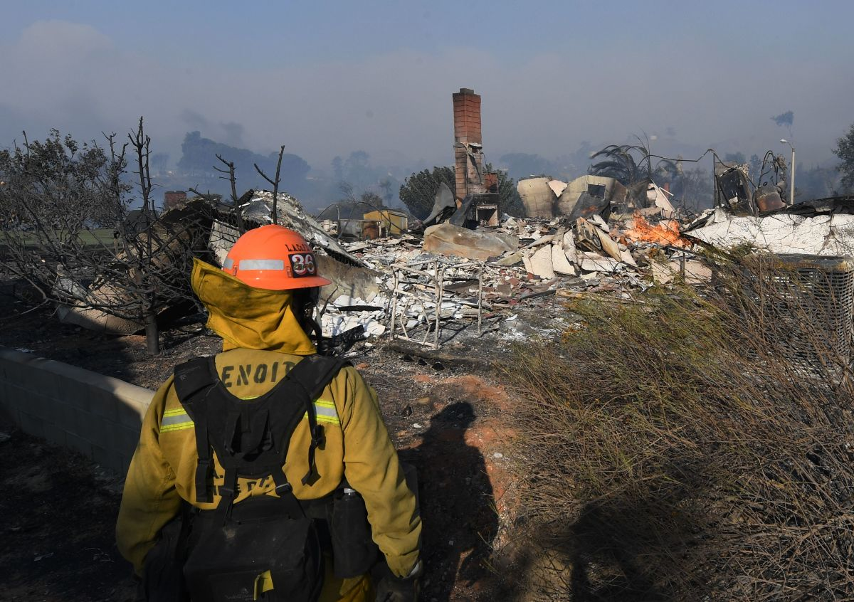 A firefighter looks at a house burnt to the ground during the Thomas wildfire in Ventura, California.