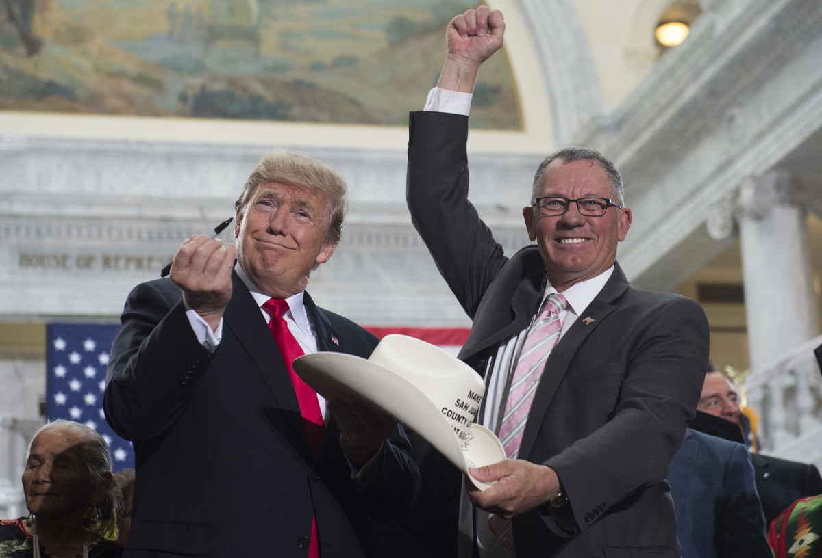President Donald Trump holds up a pen after signing a presidential proclamation shrinking Bears Ears and Grand Staircase-Escalante national monuments at the Utah State Capitol in Salt Lake City, Utah, on December 4th, 2017.